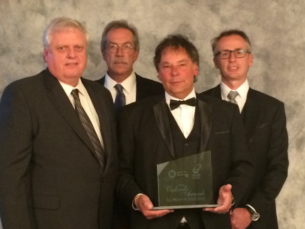 Media Resources leadership team accepts award From left: Keith Edwards, Will Thompson, Steve Gallow, and Jeff Rushton